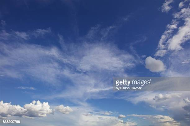 poetic blue sky cloudscape - wispy stock photos and pictures