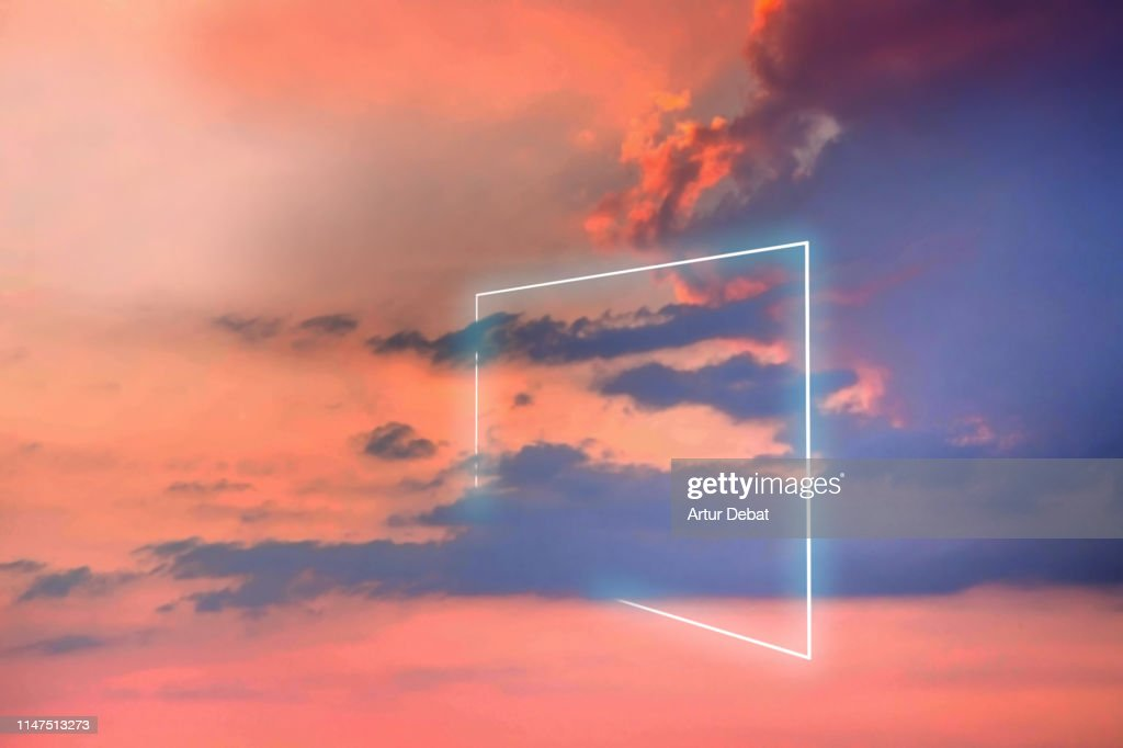Poetic neon square light between the clouds in beautiful sunset sky. : Stock Photo