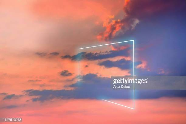 poetic neon square light between the clouds in beautiful sunset sky. - futuristisch stockfoto's en -beelden