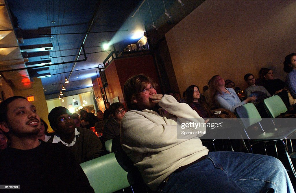 Poetry fans watch a reading at the Bowery Poetry Club December 6, 2002 in New York City. The Bowery Poetry Club, which offers nightly poetry readings, open microphone and poetry slams, is part of a resurgence in poetry reading in New York City.