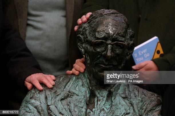 Poet's and contributors to 'If You Ever Go A map of Dublin in Poetry and Song' rest their hands on the Patrick Kavanagh statue on the Grand Canal in...