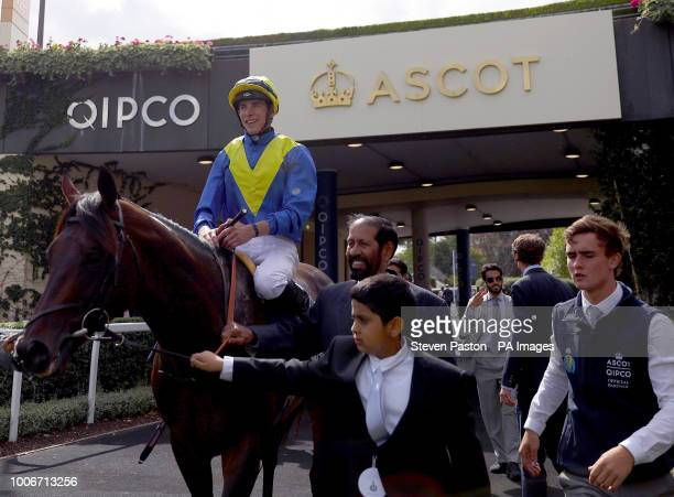 Poet's Word ridden by jockey James Doyle after winning the King George VI And Queen Elizabeth Stakes during King George Day at Ascot Racecourse