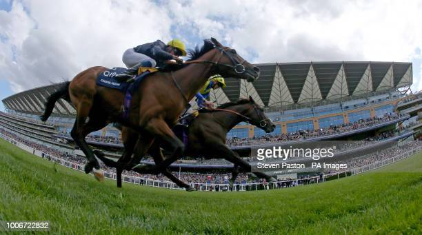 Poet's Word ridden by jockey James Doyle winning the King George VI And Queen Elizabeth Stakes during King George Day at Ascot Racecourse