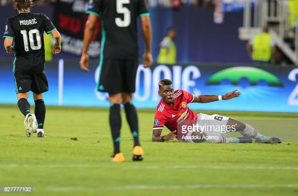 Pogba of Manchester United is seen on the floor during the UEFA Super Cup final between Real Madrid and Manchester United at the Philip II Arena on...