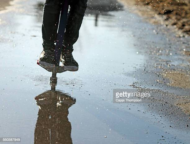 Pogo sticking in a puddle