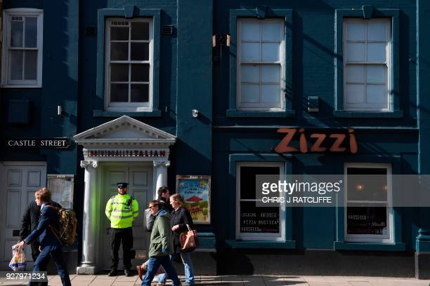 A poice officer stands guard outside a branch of the Italian chain restaurant Zizzi close to The Maltings shopping centre in Salisbury southern...