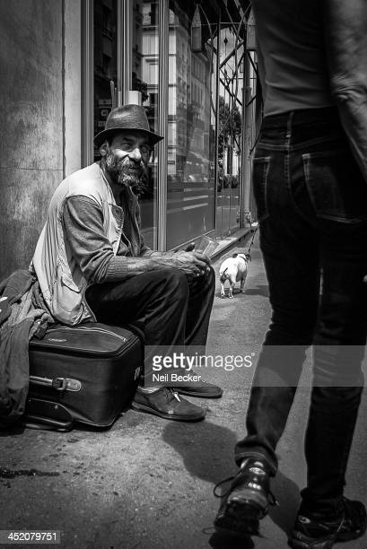 CONTENT] A poignant moment caught on camera a homeless man with his possessions observes daily life as people go by