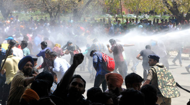 Poilce use water cannon on protesting students during the allparty protest for fee hike outside VC office at Panjab University on April 11 2017 in...