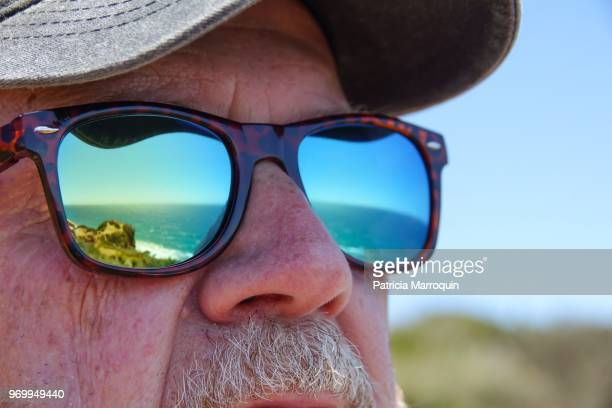 Point Dume Beach reflected in sunglasses