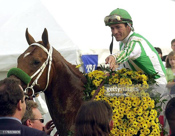 Point Given jockey Gary Stevens arrives in the winners circle after his horse won the 126th running of the Preakness Stakes at Pimlico Race Course in...