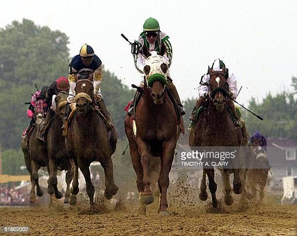 Point Given with jockey Gary Stevens aboard crosses the finish line to win the 126th running of the Preakness Stakes at Pimlico Race Course in...
