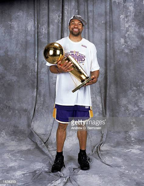 Point guard Derek Fisher of the Los Angeles Lakers poses for a studio portrait with the championship trophy immediately after winning Game Four of...