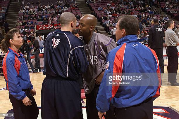 Point guard Jason Kidd of the New Jersey Nets hugs point guard Stephon Marbury of the Phoenix Suns during the NBA game at Continental Airlines Arena...
