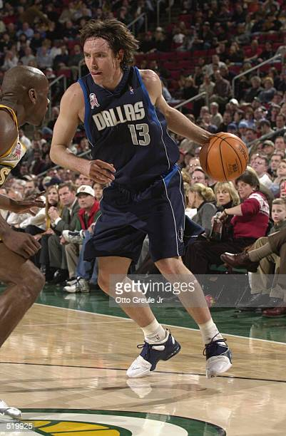 Point guard Steve Nash of the Dallas Mavericks dribbles the ball during the game against the Seattle SuperSonics at Key Arena in Seattle, Washington...