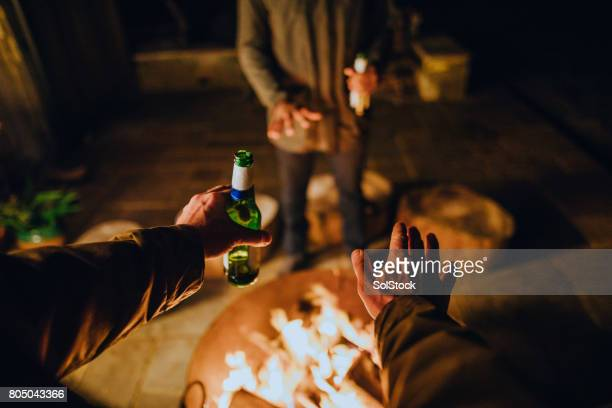 point of view by the fire with friends - fire pit stock pictures, royalty-free photos & images