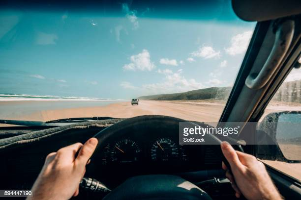 point of view driving on fraser island - driver stock pictures, royalty-free photos & images