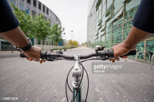 point of view from a businessman cycling to work - green blazer stock pictures, royalty-free photos & images