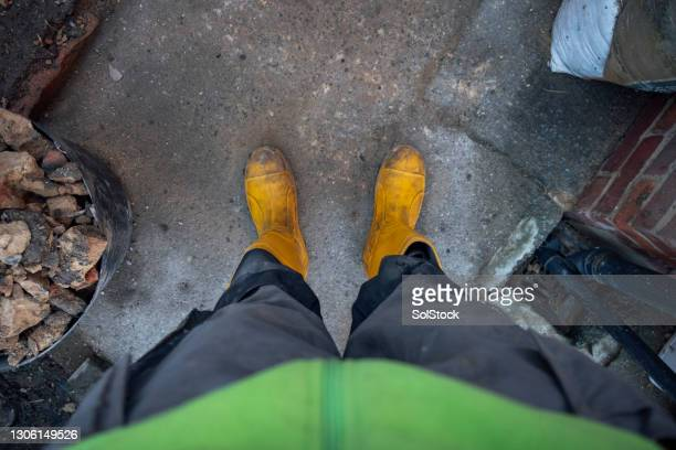 point of view from a construction worker - footwear stock pictures, royalty-free photos & images