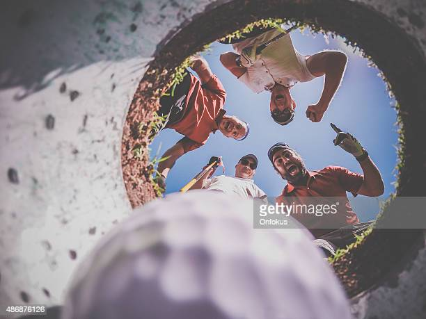 point of view golf players and ball from inside hole - hole stock pictures, royalty-free photos & images