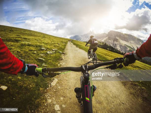 point of view pov mountain bike on the dolomites - unusual angle stock pictures, royalty-free photos & images