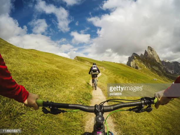 point of view pov mountain bike on the dolomites - alto adige italy stock pictures, royalty-free photos & images