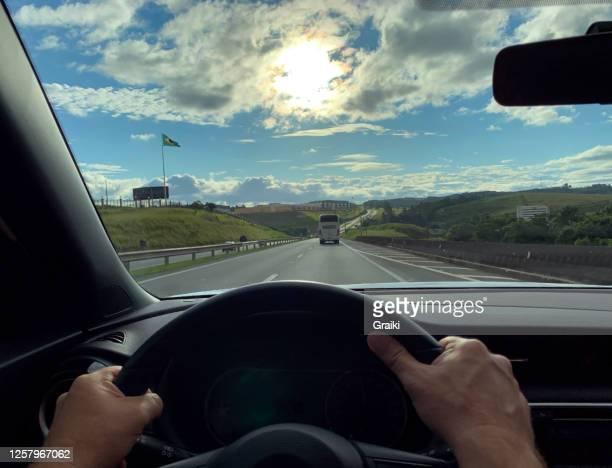 point of view of a man driver on the highway - front view bildbanksfoton och bilder