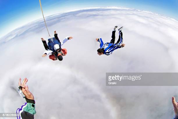 Point of view of a parachutist cameraman photographing a tandem jump