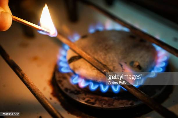 Point of view of a person lighting a gas burner with a match isolated