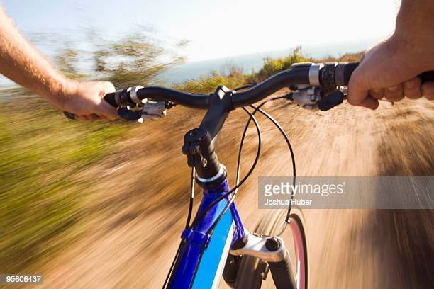 Point of view of a the handlebars of a mountain biker in Malibu, California. (motion blur)