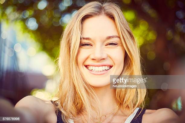 Point of view of beautiful blond woman taking selfie