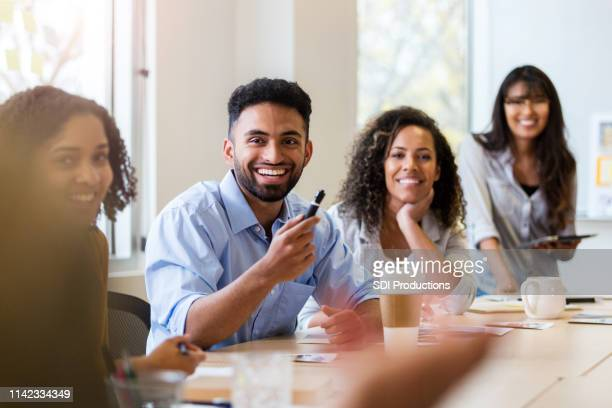 point of view of business person in staff meeting - conference table stock pictures, royalty-free photos & images