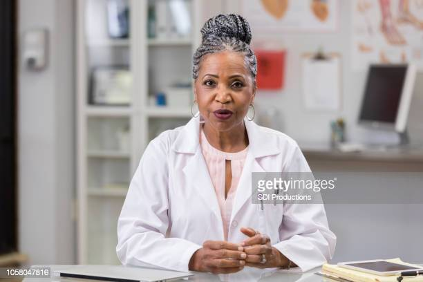 point of view of patient receiving news from physician - lab coat stock pictures, royalty-free photos & images