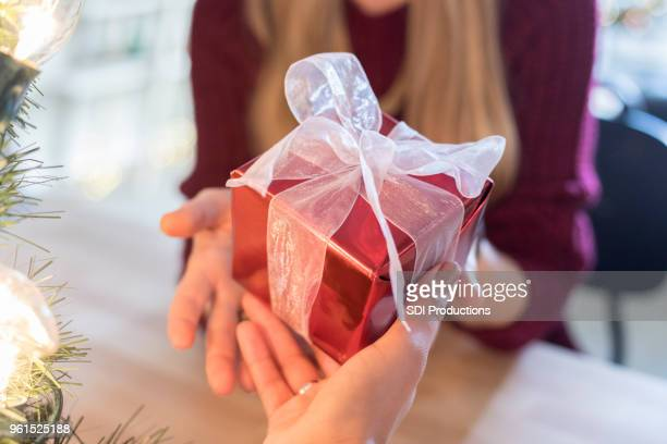 Point of view of someone who is giving Christmas gift