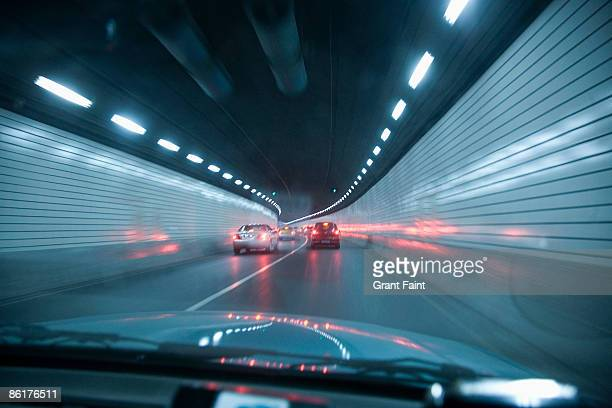 point of view out front of car in tunnel - tail light stock pictures, royalty-free photos & images
