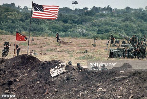 Point Salinas Grenada The Stars and Stripes fly over a dirt embankment as soldiers man 105mm Howitzers along the airport runway 10/27 Filed