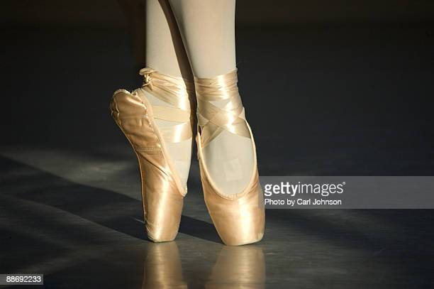 Pointe shoes in golden hour light