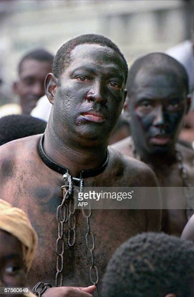 Pointe-a-Pitre, FRANCE : A picture taken 27 May 1998 shows actors taking part in the reenactment of slaves being sold to French colons upon their...