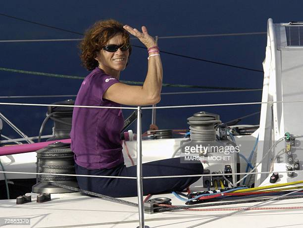 French sailor Anne Liardet waves aboard her Imoca class monohull Roxy 15 November 2006 as she arrives eigth at PointeaPitre French West Indies in the...
