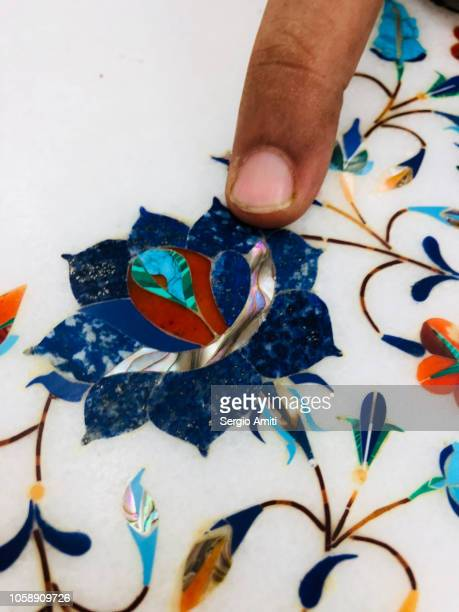 Pointing at a detail in a pietra dura artwork