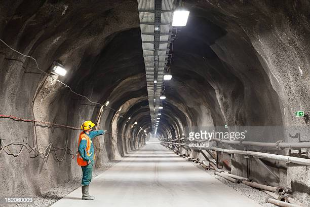 pointing downward in a tunnel/mine - underground stock photos and pictures