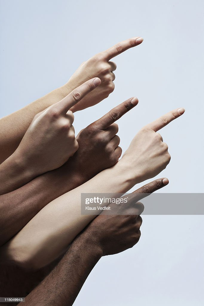 5 pointing fingers of multiple ethnicities : Stock Photo