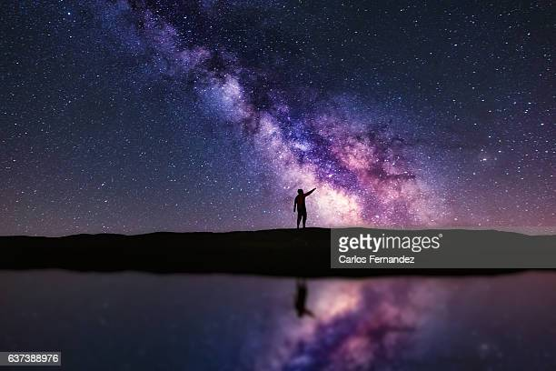 pointing the milky way - nebula stock pictures, royalty-free photos & images