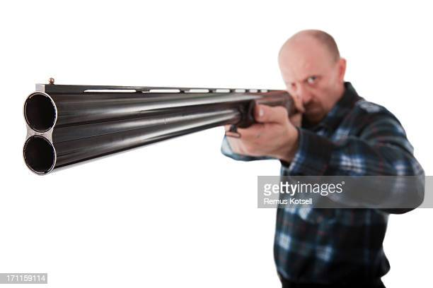 pointing the shotgun - shotgun stock pictures, royalty-free photos & images