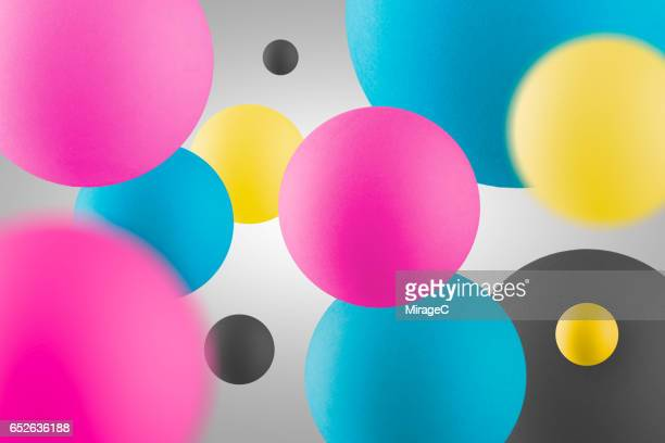 cmyk points ballls in air - bouncing ball stock photos and pictures