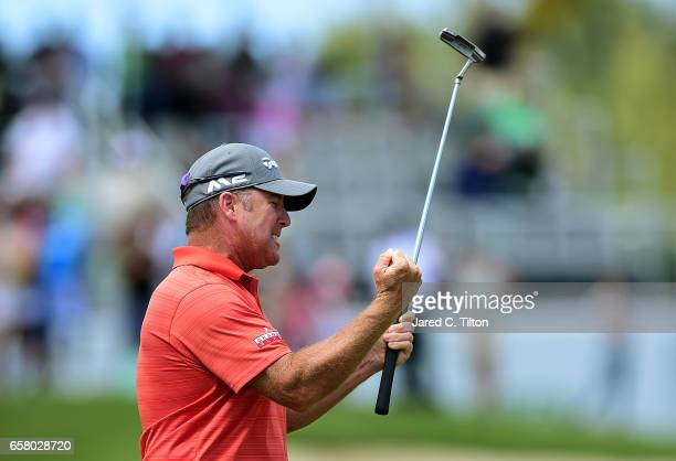 Points celebrates after making his birdie putt on the 18th green during the final round to win the Puerto Rico Open at Coco Beach on March 26, 2017...