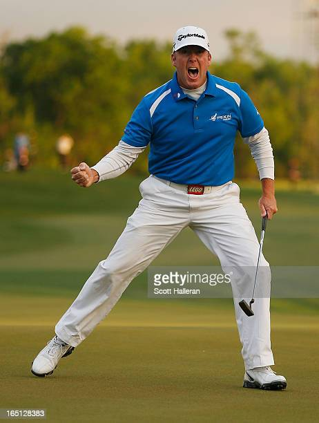Points celebrates his par putt on the 18th green during the final round of the Shell Houston Open at the Redstone Golf Club on March 31, 2013 in...
