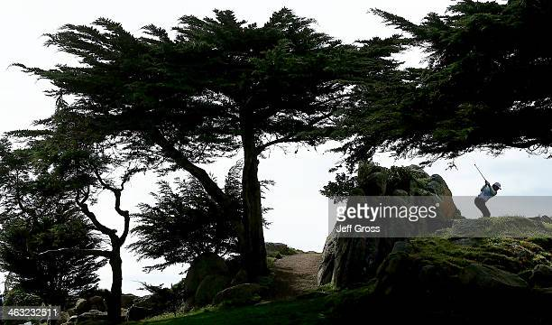 A Points hits his tee shot on the 11th hole during the first round of the ATT Pebble Beach National ProAm at the Monterey Peninsula Country Club on...