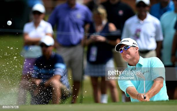 DA Points hits out of a sand trap along the 10th green during second round action of the PGA Championship at Quail Hollow Club Friday Aug 11 2017 in...