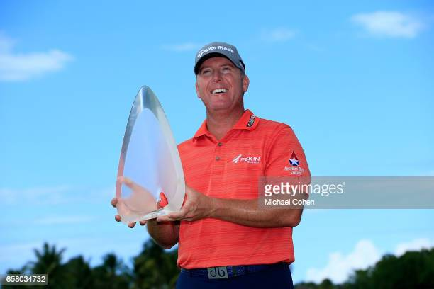 Points holds the trophy after winning the Puerto Rico Open at Coco Beach on March 26, 2017 in Rio Grande, Puerto Rico.