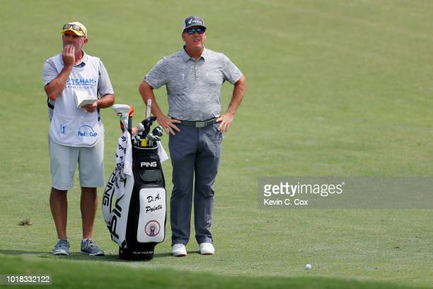 Points stands in the fairway with his caddie Mick Brennan during the second round of the Wyndham Championship at Sedgefield Country Club on August...
